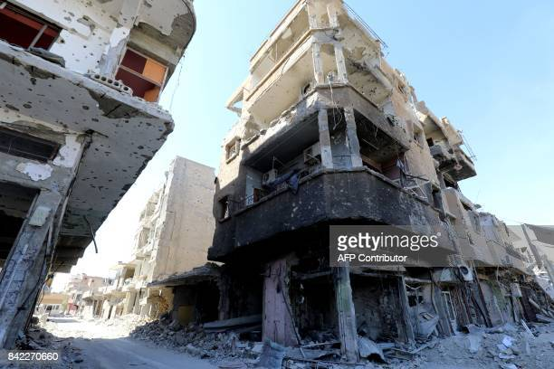 A general view of destroyed buildings is seen in the embattled northern Syrian city of Raqa on September 3 as Syrian Democratic Forces a US backed...