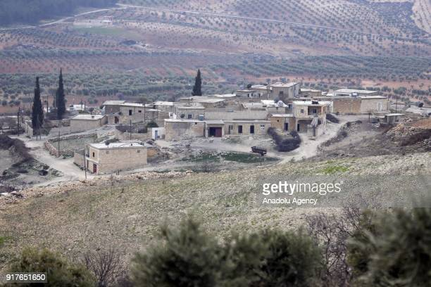 A general view of Dikmetas village as Free Syrian Army members patrol during search operations continue after Turkish Armed Forces and FSA members...