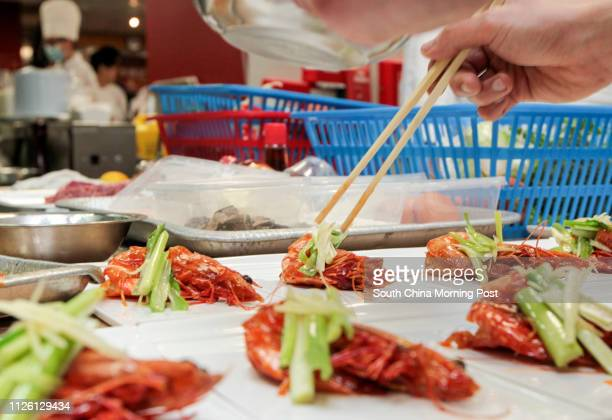 General view of dishes being prepared by chefs during Lee Kum Kee International Young Chef Chinese Culinary Challenge Final cooking competition at...