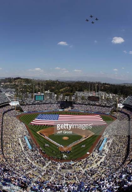 A general view of Dodger Stadium is seen during a flyover and the singing of the national anthem prior to the start of the home opener game between...