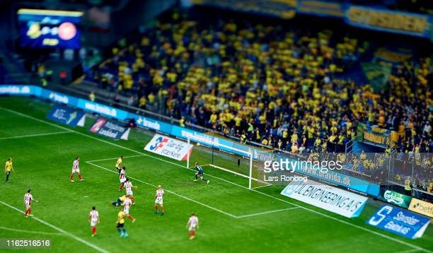General view of Dominik Kaiser of Brondby IF scoring the 1-0 goal against Goalkeeper Jacob Rinne of AaB Aalborg during the Danish 3F Superliga match...