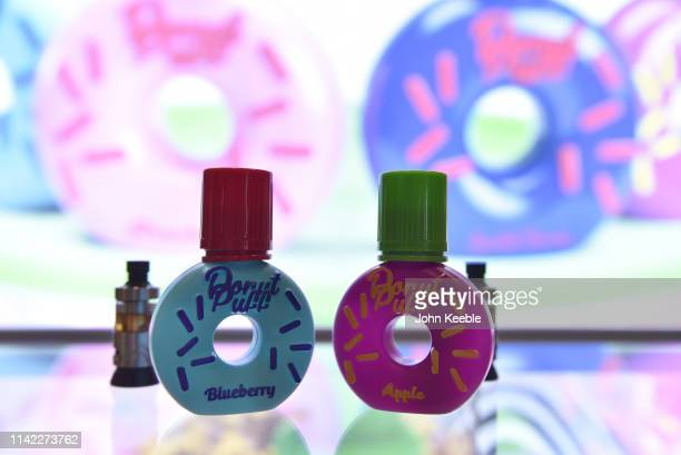 A general view of Donut Puff Blueberry and Apple flavoured ELiquid on display during Vape Jam 2019 at ExCel on April 12 2019 in London England Vape...