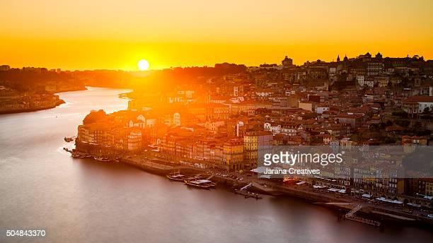 General view of Douro river and city of Oporto al sunset. Porto (Oporto), Portugal