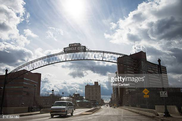 General View of downtown Flint as well as the famed arches bearing the city's nickname 'Vehicle City' on March 17 2016 in Flint Michigan Flint...