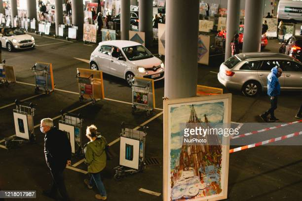 general view of drive in gallery during the opening of drive in Gallery's show Nachtbroetchen 20 at Cologne airport parking lot amid the coronavirus...