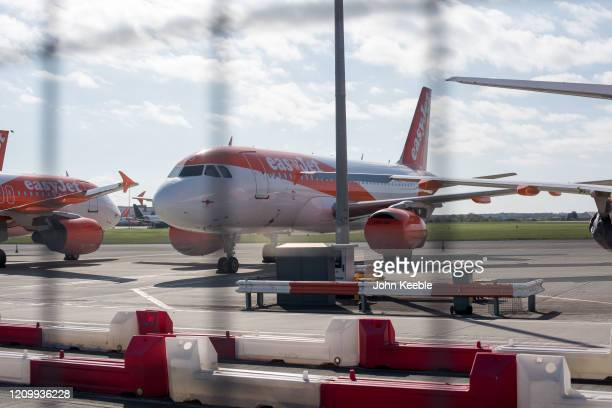 A general view of Easyjet passenger planes parked at Southend Airport on April 14 2020 in London United Kingdom EasyJet has currently grounded its...