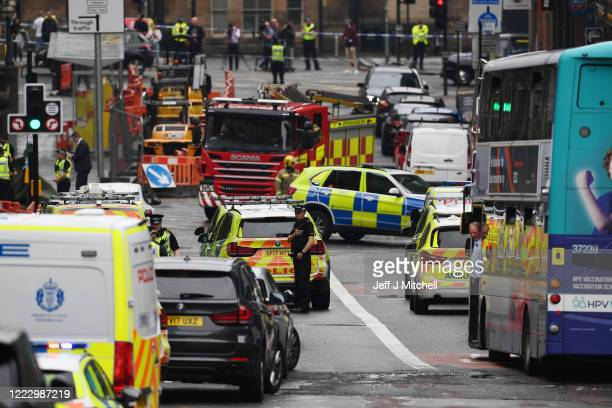 General view of emergency services at the scene after there were initial reports of three people being killed in a central Glasgow hotel on June 26,...
