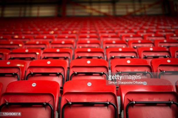A general view of empty red seats before the Premier League match between Sheffield United and Brighton Hove Albion at Bramall Lane on February 22...