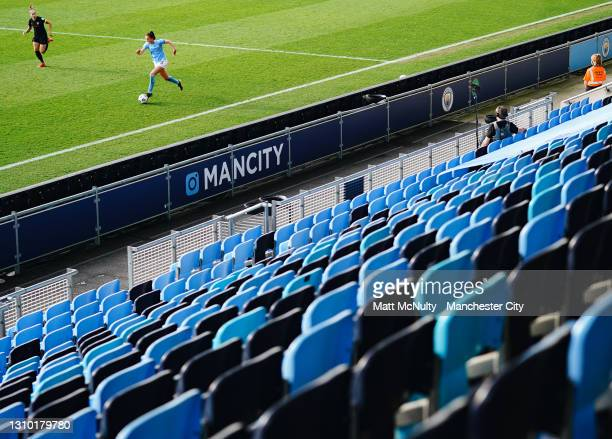 General view of empty seats during the behind closed doors match as Caroline Weir of Manchester City attacks during the Second Leg of the UEFA...