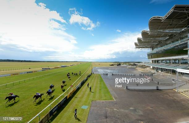 A general view of empty stands as Kameko ridden Oisin Murphy approaches the finish line to win the Qipco 2000 Guineas Stakes at Newmarket Racecourse...