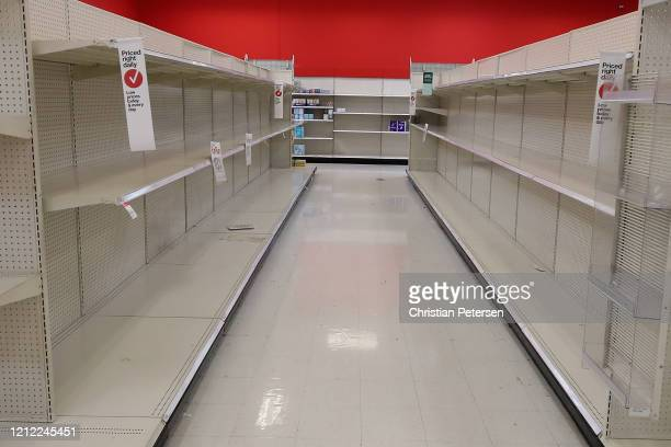 General view of empty toilet paper and paper towel shelves at a Target store on March 13 2020 in Glendale Arizona Some Americans are stocking up on...