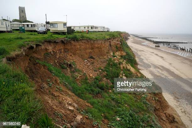 General view of erosion to the cliff face , close to holiday caravans in the village of Happisburgh on June 4, 2018 in Great Yarmouth, England. The...