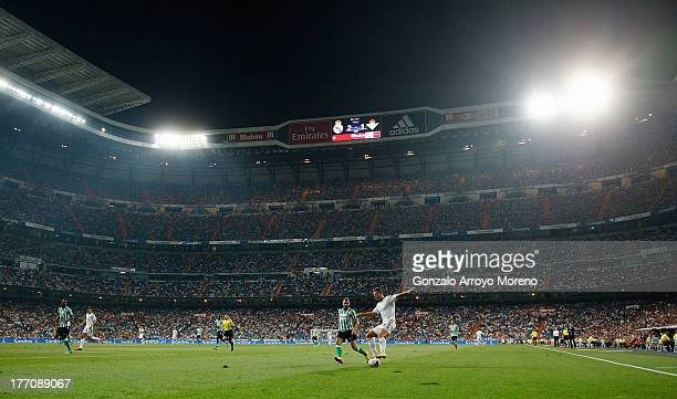 general view of Estadio Santiago Bernabeu pitch at night with Cristiano Ronaldo of Real Madrid CF controlling the ball during the La Liga match...
