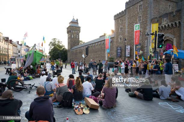 A general view of Extinction Rebellion protestors with a green boat on Duke Street outside Cardiff Castle as the environmental protest group ends day...
