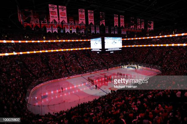 General view of fans and players stand at attention as Canada's National Anthem is performed prior to the start of Game 3 of the Eastern Conference...