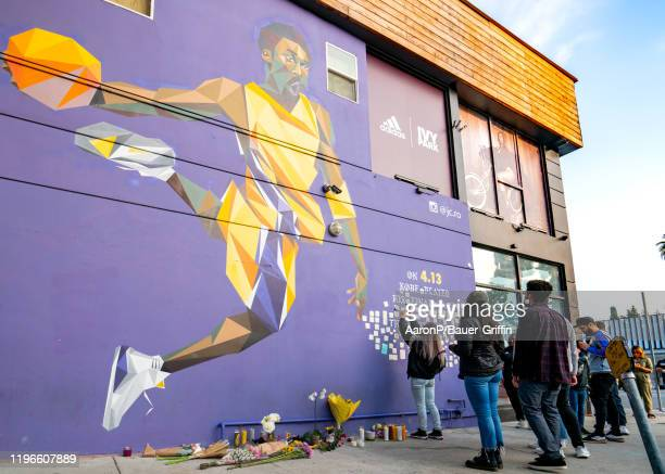 A general view of fans gathering at the Kobe Bryant mural on Melrose Ave in Hollywood to honor the NBA Star after the announcement of his death on...