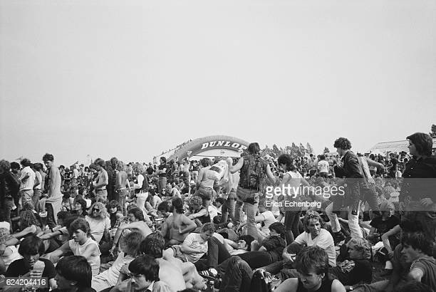 A general view of fans in the audience and the Dunlop Bridge in the background at Monsters Of Rock festival Donington Park Leicestershire United...