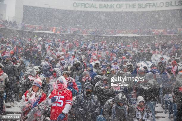 General view of fans in the lower level as snow falls during the first quarter of the game between the Buffalo Bills and the Indianapolis Colts at...