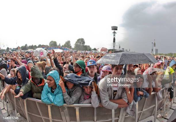 General view of fans in the rain on Day 3 of Wireless Festival at Hyde Park on July 8, 2012 in London, United Kingdom.
