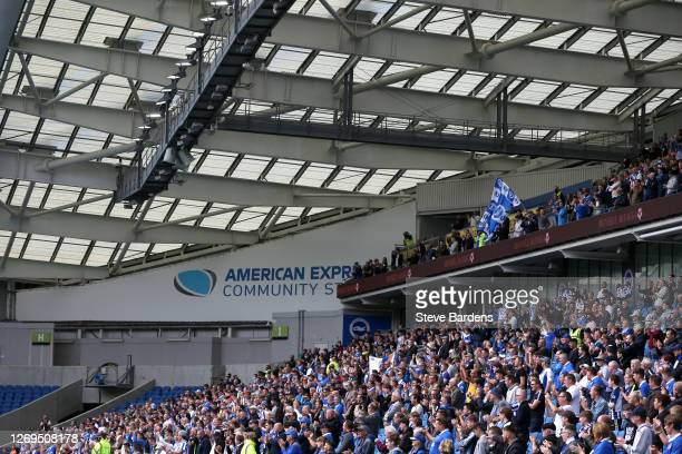 General view of fans inside the stadium as fans return as part of a pilot event following the coronavirus pandemic during the pre-season friendly...