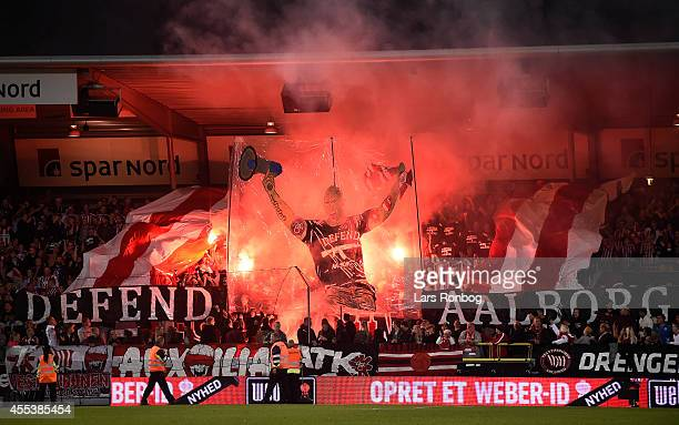 General view of fans of AaB Aalborg using tifo and pyrotechnics prior to the Danish Superliga match between AaB Aalborg and FC Copenhagen at...