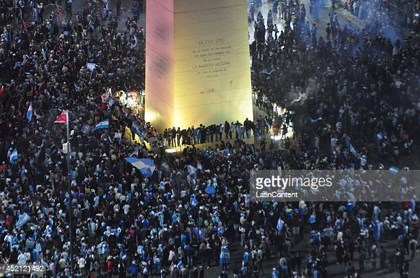 General view of fans of Argentina after FIFA World Cup final match between Germany and Argentina at Obelisco monument in 9 de Julio Avenue on July 13...