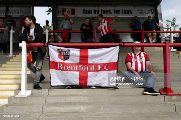 A general view of fans on the terrace with a flag at Griffin Park home stadium of Brentford during the Sky Bet Championship match between Brentford...