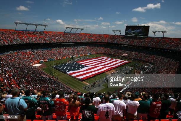 A general view of fans standing for the playing of the National Anthem prior to the NFL game between the New York Jets and the Miami Dolphins at...