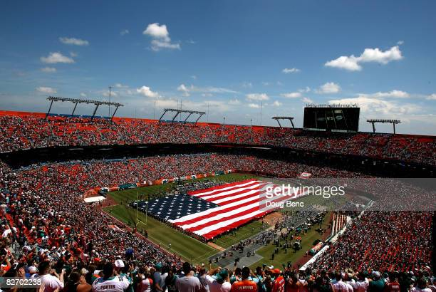 General view of fans standing for the playing of the National Anthem prior to the NFL game between the New York Jets and the Miami Dolphins at...