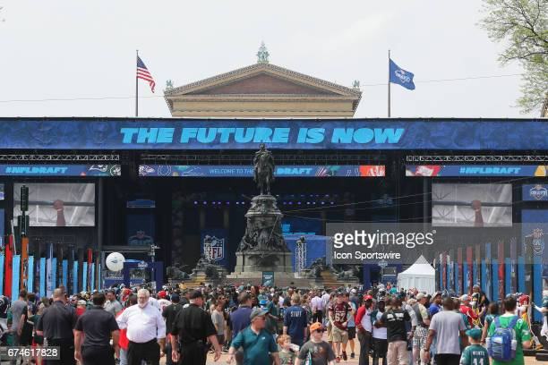 A general view of fans walking in front of the NFL Draft Theater on April 27 2017 in Philadelphia PA