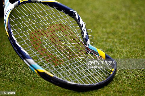 A general view of Feliciano Lopez's broken tennis racket after losing his Gentlemen's Singles first round match against Jarkko Nieminen of Finland on...