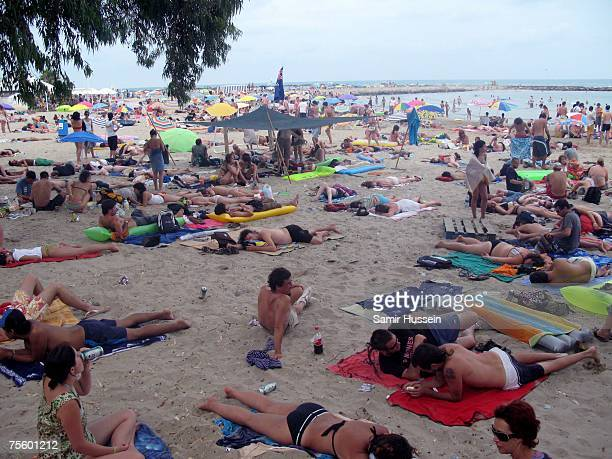 A general view of festivalgoers relaxing on the beach during the International Festival of Benicassim on July 22 2007 in Benicassim Spain The...