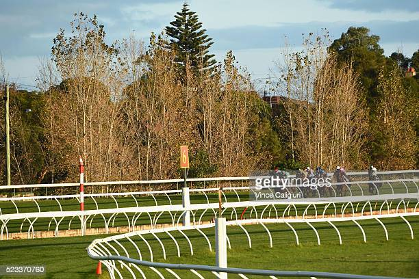 General view of field racing down the back straight in Race 9 during Melbourne Racing at Caulfield Racecourse on April 23 2016 in Melbourne Australia