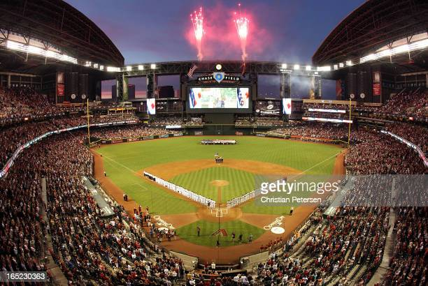 General view of fireworks exploding as the St Louis Cardinals and the Arizona Diamondbacks stand attended for the National Anthem before the MLB...