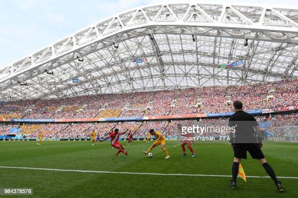 General view of Fisht stadium as Mathew Leckie of Australia runs with the ball at Edison Flores and Miguel Trauco of Peru during the 2018 FIFA World...