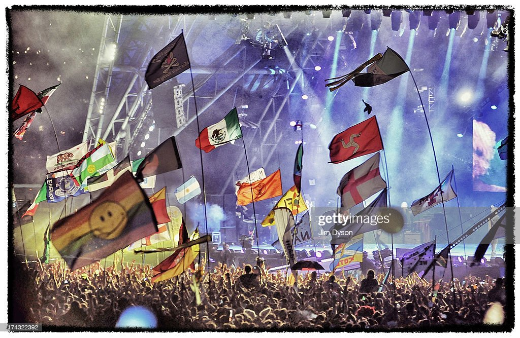 A general view of flags in the crowd as the Rolling Stones perform on the Pyramid stage during day 3 of the 2013 Glastonbury Festival at Worthy Farm on June 29, 2013 in Glastonbury, England.