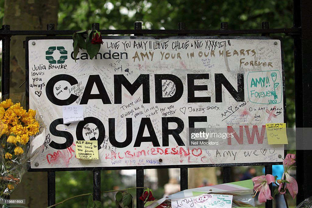 General view of flowers, candles and cards at Amy Winehouse's home in Camden Square on the day of her funeral on July 26, 2011 in London, England.