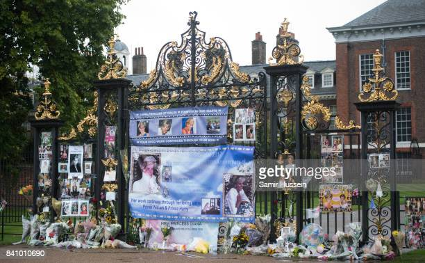 A general view of flowers photos and other souvenirs left as a tribute to Princess Diana near The Sunken Garden at Kensington Palace on August 30...