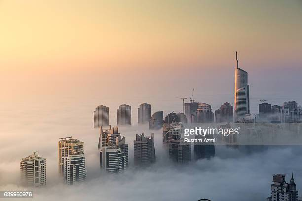 General view of Foggy Morning of Jumeirah Lake Towers captured from 73rd floor of cayan tower on December 05 2016 in Dubai United Arab Emirates