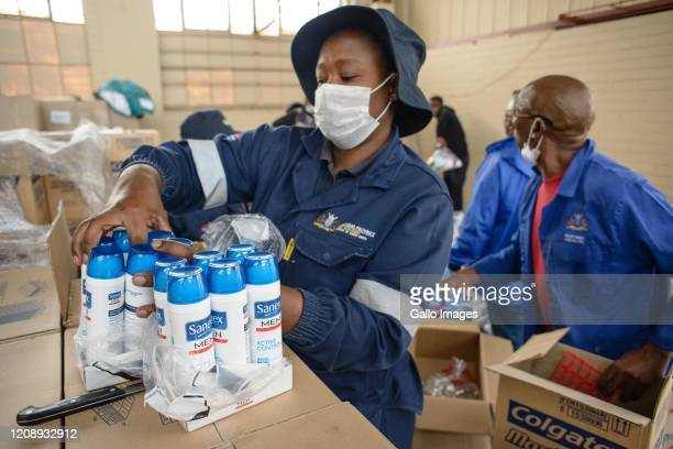 General view of food and sanitary parcels being packed and loaded for distribution at the Gauteng Social Development Warehouse on Day Six of National...