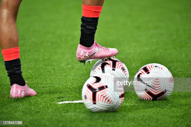 General View of football boots on a ball prior to the Premier League match between Aston Villa and Liverpool at Villa Park on October 04, 2020 in...
