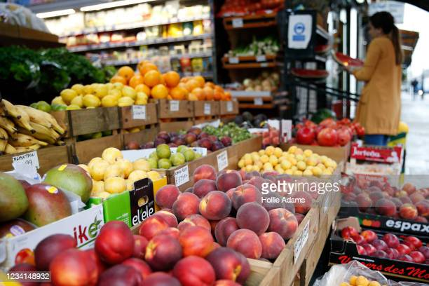 General view of fresh fruit and vegetable produce displayed outside a shop on Green Lanes in Haringey on February 28, 2021 in London, England.