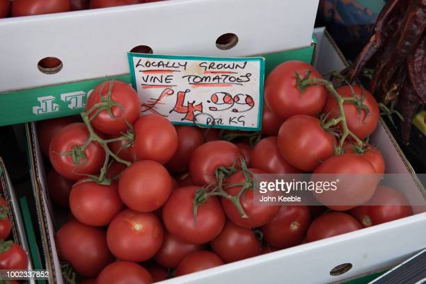 A general view of fresh locally grown vine tomatoes for sale outside a green grocer store in the Cotswolds on July 10 2018 in Broadway England