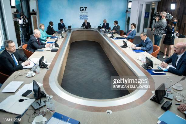 General view of G7 leaders and their guests is pictured at a working sesssion during the G7 summit in Carbis Bay, Cornwall on June 12, 2021. - G7...