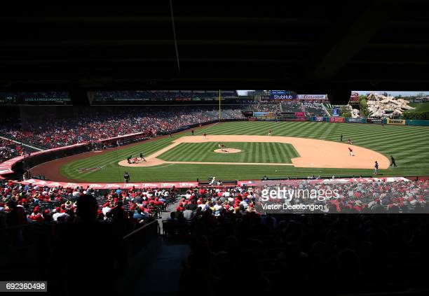 A general view of game action is seen as pitcher Yusmeiro Petit of the Los Angeles Angels of Anaheim pitches to Brian Dozier of the Minnesota Twins...