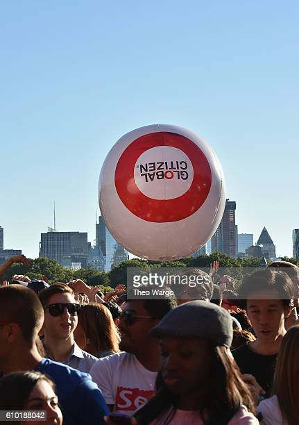 A general view of giant beach balls with the Global Citizen logo in the crowd at the 2016 Global Citizen Festival In Central Park To End Extreme...