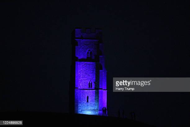 General view of Glastonbury Tor as it is lit up Blue as a mark of respect to the NHS and Key Workers on May 14, 2020 in Glastonbury, England. The...