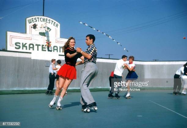 General view of Gloria dancing with a friend while roller skating circa November 1954 at the Westchester SkateLand in Westchester New York