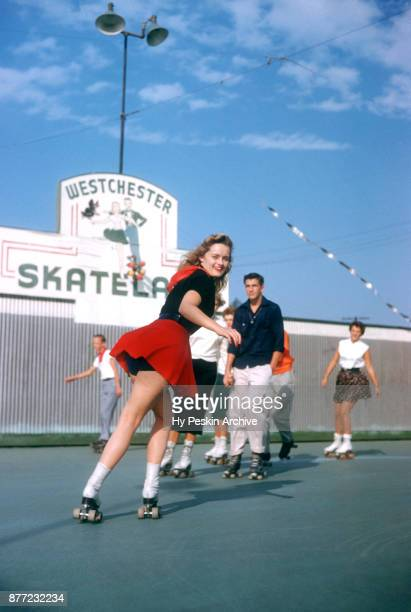 General view of Gloria roller skating backwards circa November 1954 at the Westchester SkateLand in Westchester New York