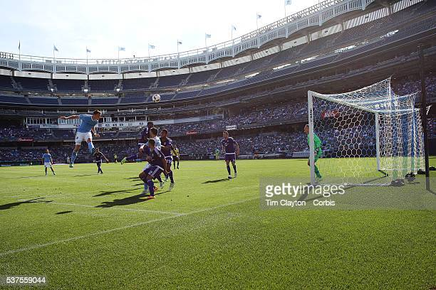 A general view of goalmouth action at Yankee Stadium as Frederic Brillant of New York City FC heads just over the bar during the New York City FC Vs...